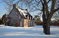 Former presbytery of Deschambault, built in 1815, now used as an exhibition hall, in Deschambault, Cap Lauzon, on the Chemin du Roy, Quebec, Canada. The presbytery formed part of a catholic community, including a convent, church, 2 presbyteries, a cemetery and a residents' hall. The Chemin du Roy or King's Highway is a historic road along the Saint Lawrence river built 1731-37, connecting communities between Quebec City and Montreal. Picture by Manuel Cohen