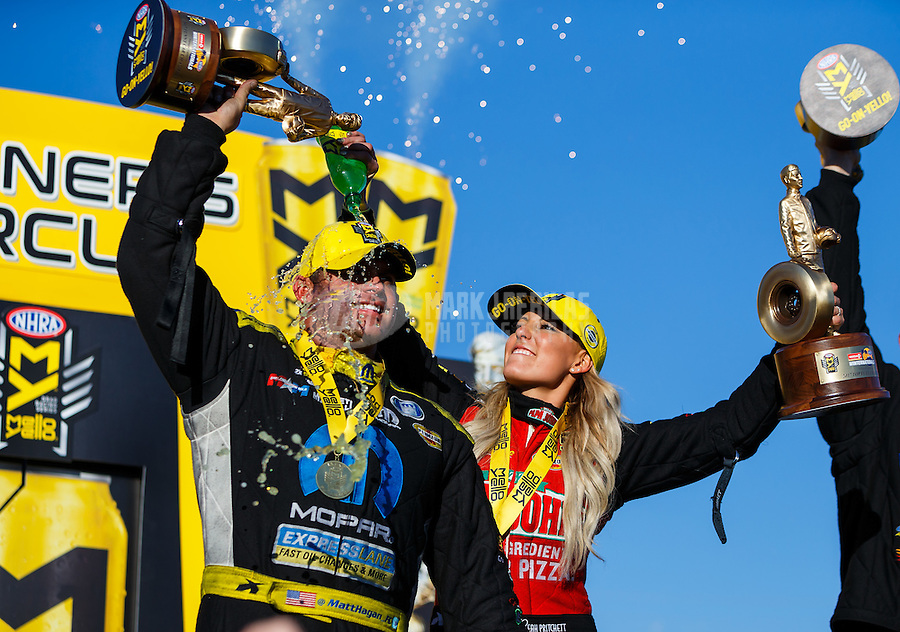 Feb 12, 2017; Pomona, CA, USA; NHRA top fuel driver Leah Pritchett (right) dumps Mello Yello soda on the head of funny car winner Matt Hagan as they celebrate after winning the Winternationals at Auto Club Raceway at Pomona. Mandatory Credit: Mark J. Rebilas-USA TODAY Sports