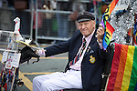 "© Joel Goodman - 07973 332324 . 23/08/2014 .  Manchester , UK . The oldest gay in the village , on his mobility scooter . The parade through Manchester City Centre . Manchester Pride "" Big Weekend "" in Manchester "" today ( 23rd August 2014 ) . Photo credit : Joel Goodman"