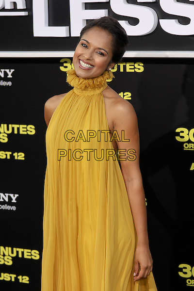 "DILSHAD VADSARIA.World premiere of Columbia Pictures' ""30 Minutes Or Less"" at Grauman's Chinese Theatre. Hollywood, CA USA. .August 8th, 2011.half length yellow sleeveless dress gold  high collar sheer .CAP/CEL.©CelPh/Capital Pictures"