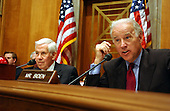 United States Senator Joseph Biden (Democrat of Delaware), ranking member, right, questions a witness at a hearing of the United States Senate Foreign Relations Committee to review the United Nations Oil-for-Food Program in Washington, D.C. on April 7, 2004.  United States Senator Richard Lugar (Republican of Indiana), Chairman, left, listens to the questioning..Credit: Ron Sachs / CNP.
