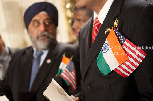 Washington, DC - November 24, 2009 -- Sante Chary, right, and Mohinder Taneja await a ceremony with United States President Barack Obama and Manmohan Singh, India's prime minister, in Washington, D.C., U.S., on Tuesday, November 24, 2009. Singh was welcomed to the White House this morning by Obama for a state visit where the two leaders will have discussions on curbing nuclear weapons, climate change and trade. .Credit: Andrew Harrer - Pool via CNP