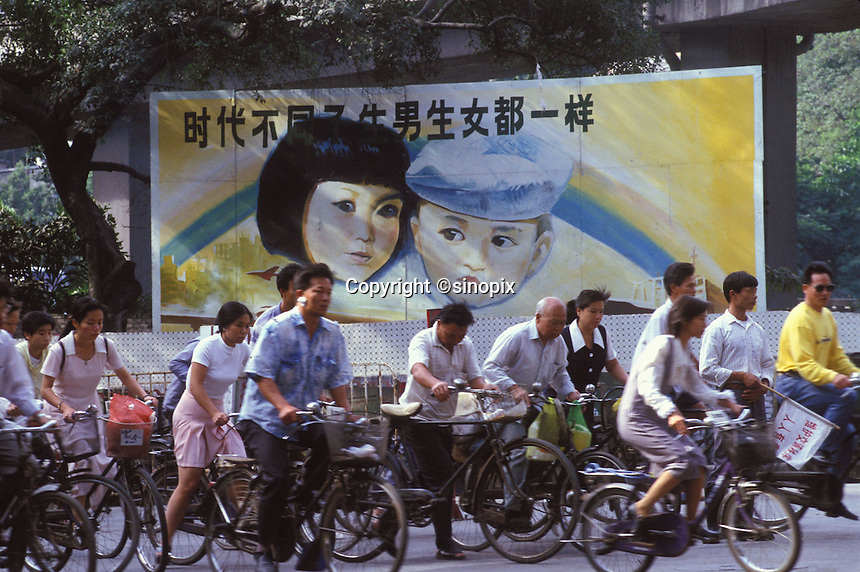 "Comuters pass a Government Propaganda poster that says ""boys and girls are equal in society"". An average gender inbalance of 118 males to 100 females caused by the Chinese Governments One Child Policy and the  preference for boys means that there is a shortage of women in China."