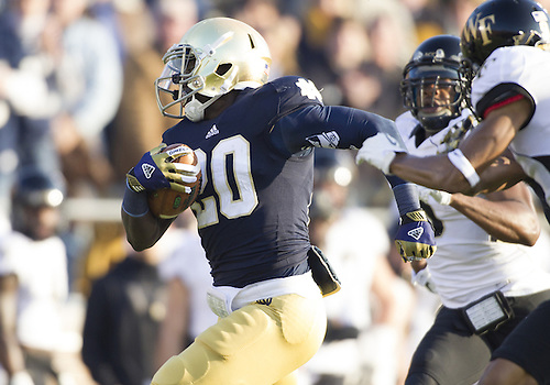 November 17, 2012:  Notre Dame running back Cierre Wood (20) runs for yardage during NCAA Football game action between the Notre Dame Fighting Irish and the Wake Forest Demon Deacons at Notre Dame Stadium in South Bend, Indiana.  Notre Dame defeated Wake Forest 38-0.
