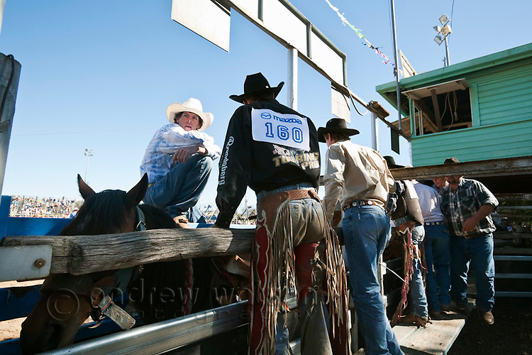 Cowboys await the start of the bronc riding competition at the Mareeba Rodeo.  Mareeba, Queensland, Australia