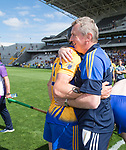 Donal Moloney, Clare joint manager hugs David Mc Inerney following their All-Ireland quarter final against Wexford at Pairc Ui Chaoimh. Photograph by John Kelly.