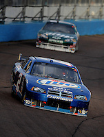 Nov. 9, 2008; Avondale, AZ, USA; NASCAR Sprint Cup Series driver Kurt Busch (2) leads Dale Earnhardt Jr during the Checker Auto Parts 500 at Phoenix International Raceway. Mandatory Credit: Mark J. Rebilas-