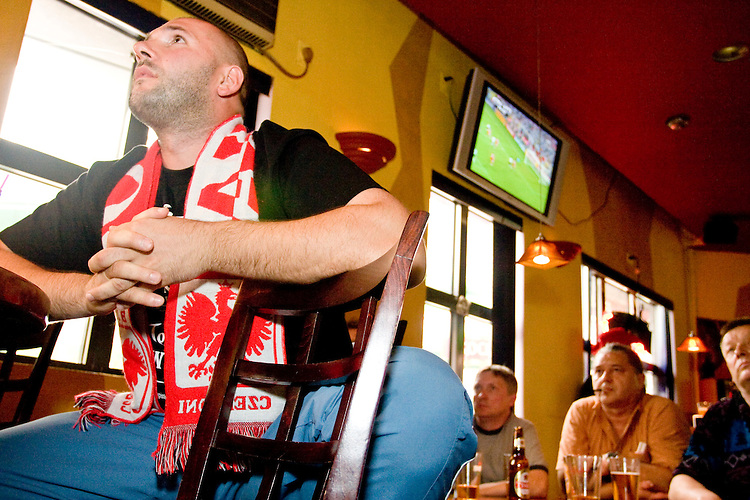 Poland fan Jack watches his team's World Cup match against Germany on June 14, 2006 at the Fireplace, a bar in a Polish section of Brooklyn.<br /> <br /> The World Cup, held every four years in different locales, is the world's pre-eminent sports tournament in the world's most popular sport, soccer (or football, as most of the world calls it).  Qualification for the World Cup is open to any country with a national team accredited by FIFA, world soccer's governing body. The first World Cup, organized by FIFA in response to the popularity of the first Olympic Games' soccer tournaments, was held in 1930 in Uruguay and was participated in by 13 nations.    <br /> <br /> As of 2010 there are 208 such teams.  The final field of the World Cup is narrowed down to 32 national teams in the three years preceding the tournament, with each region of the world allotted a specific number of spots.  <br /> <br /> The World Cup is the most widely regularly watched event in the world, with soccer teams being a source of national pride.  In most nations, the whole country is at a standstill when their team is playing in the tournament, everyone's eyes glued to their televisions or their ears to the radio, to see if their team will prevail.  While the United States in general is a conspicuous exception to the grip of World Cup fever there is one city that is a rather large exception to that rule.  In New York City, the most diverse city in a nation of immigrants, the melting pot that is America is on full display as fans of all nations gather in all possible venues to watch their teams and celebrate where they have come from.