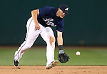 Reno Aces' Nick Ahmed makes a play against the Omaha Storm Chasers, in Reno, Nev., on Sunday, Aug. 24, 2014.<br /> Photo by Cathleen Allison