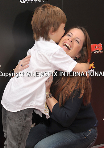 "HOLLY MARIE COMBS AND SON.attends the World Premiere of ""Spy Kids: All The Time In The World"" at the Regal Cinemas, L.A. Live, Los Angeles, California_31/07/2011.Mandatory Photo Credit: ©Crosby/Newspix International. .**ALL FEES PAYABLE TO: ""NEWSPIX INTERNATIONAL""**..PHOTO CREDIT MANDATORY!!: NEWSPIX INTERNATIONAL(Failure to credit will incur a surcharge of 100% of reproduction fees).IMMEDIATE CONFIRMATION OF USAGE REQUIRED:.Newspix International, 31 Chinnery Hill, Bishop's Stortford, ENGLAND CM23 3PS.Tel:+441279 324672  ; Fax: +441279656877.Mobile:  0777568 1153.e-mail: info@newspixinternational.co.uk"