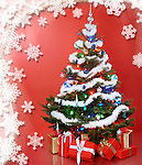 Decorated Christmas tree with gifts under it on red background with snowflake pattern around it