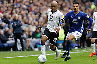 (L-R) Andre Ayew of Swansea City and Robert Glatzel of Cardiff City in action during the Sky Bet Championship match between Cardiff City and Swansea City at the Cardiff City Stadium, Cardiff, Wales, UK. Sunday 12 January 2020