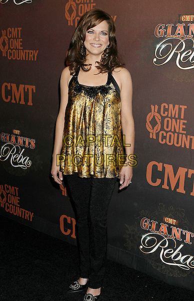 """MARTINA McBRIDE.Arrivals at """"CMT Giants"""" Honoring Reba McEntire held at the Kodak Theatre, Hollywood, LA, California, USA,.26 October 2006..full length gold and black top.Ref: ADM/RE.www.capitalpictures.com.sales@capitalpictures.com.©Russ Elliot/AdMedia/Capital Pictures."""