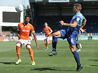 Blackpool's Michael Nottingham watches on as Wycombe Wanderers' Adam El-Abd clears<br /> <br /> Photographer Kevin Barnes/CameraSport<br /> <br /> The EFL Sky Bet League One - Wycombe Wanderers v Blackpool - Saturday 4th August 2018 - Adams Park - Wycombe<br /> <br /> World Copyright &copy; 2018 CameraSport. All rights reserved. 43 Linden Ave. Countesthorpe. Leicester. England. LE8 5PG - Tel: +44 (0) 116 277 4147 - admin@camerasport.com - www.camerasport.com