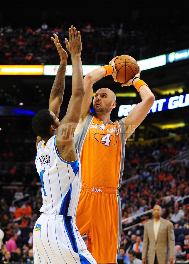 Mar. 25, 2011; Phoenix, AZ, USA; Phoenix Suns center (4) Marcin Gortat against the New Orleans Hornets at the US Airways Center. The Hornets defeated the Suns 106-100. Mandatory Credit: Mark J. Rebilas-.