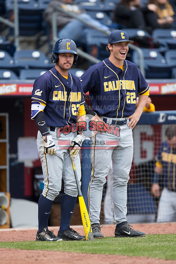 Daulton Jefferies (22) of the California Golden Bears chats with teammate Aaron Knapp (23) prior to the game against the Duke Blue Devils at Durham Bulls Athletic Park on February 20, 2016 in Durham, North Carolina.  The Blue Devils defeated the Golden Bears 6-5 in 10 innings.  (Brian Westerholt/Four Seam Images)