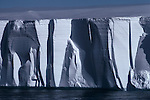 Vertical walls of a tabular iceberg convey the very essence of Antarctica's forbidding environment