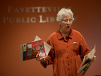 NWA Democrat-Gazette/ANDY SHUPE<br /> Nancy Hartney of Fayetteville holds retired calendars that she uses to craft her handmade cards Wednesday, Jan. 10, 2018, while leading a stationary-making workshop at the Fayetteville Public Library.