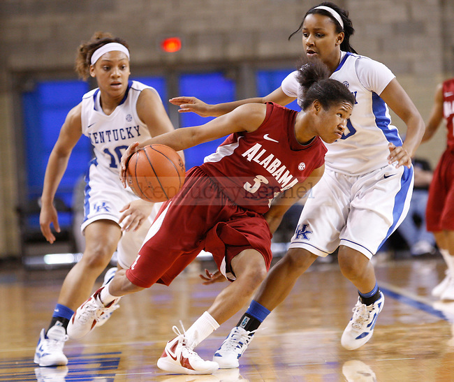UK guards Bernisha Pinkett (L) and Maegan Conwright (R) double team Alabama's Jasmine Robinson during the second half of the UK Women's basketball game against Alabama on 1/29/12 at Memorial Coliseum in Lexington, Ky. Photo by Quianna Lige | Staff