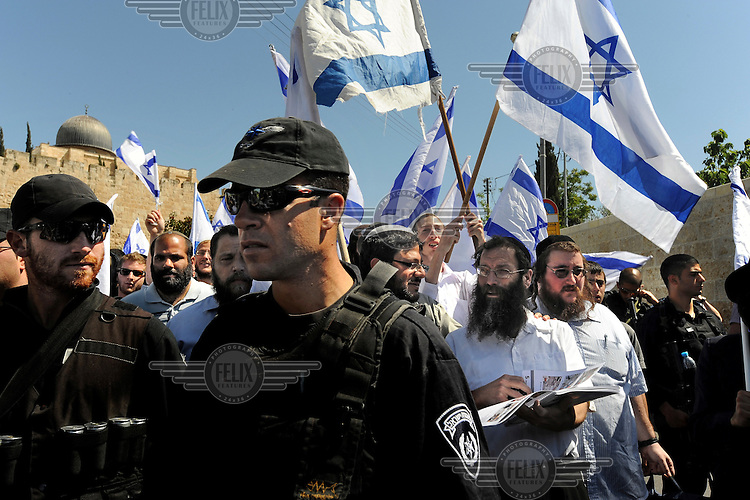 Ultra right-wing Jewish activists start their march close to Al-Aqsa Mosque, as they enter the Arab neighbourhood of Silwan. The activists have called upon authorities to demolish illegal structures built by Palestinians in Silwan.