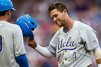 UCLA Bruin outfielder Eric Filia (4) after he is picked off of first base in the first inning of Game 4 of the 2013 Men's College World Series against the LSU Tigers on June 16, 2013 at TD Ameritrade Park in Omaha, Nebraska. UCLA defeated LSU 2-1. (Andrew Woolley/Four Seam Images)