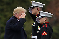 United States President Donald J. Trump salutes before boarding Marine One on departure from Walter Reed National Military Medical Center following his annual physical examination January 12, 2018 in Bethesda, Maryland. Trump will next travel to Florida to spend the Dr. Martin Luther King Jr. Day holiday weekend at his Mar-a-Lago resort. <br /> Credit: Chip Somodevilla / Pool via CNP /MediaPunch