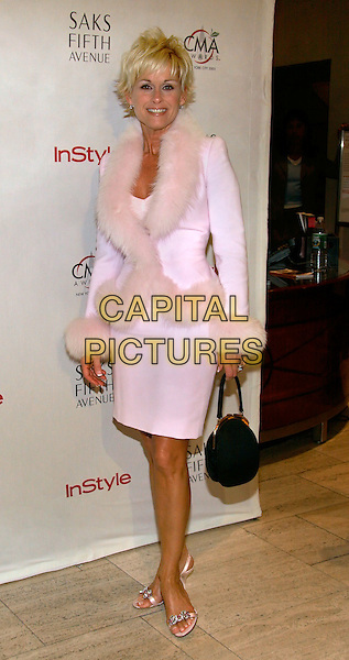 LORRIE MORGAN.The Saks Fifth Avenue and Instyle Magazine CMA Reception.  New York..USA, United States..14th November 2005.Ref: ADM/JL.full length pastel pink matching pencil skirt fur collar trim coat jacket black handbag smiling.www.capitalpictures.com.sales@capitalpictures.com.© Capital Pictures.