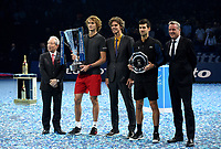 Alexander Zverev and Novack Djokovic posing with their trophies with Guga Kuerten, Hideo Takasaki and Chris Kermode <br /> <br /> Photographer Hannah Fountain/CameraSport<br /> <br /> International Tennis - Nitto ATP World Tour Finals Day 7 - O2 Arena - London - Saturday 17th November 2018<br /> <br /> World Copyright &copy; 2018 CameraSport. All rights reserved. 43 Linden Ave. Countesthorpe. Leicester. England. LE8 5PG - Tel: +44 (0) 116 277 4147 - admin@camerasport.com - www.camerasport.com
