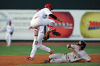 Johnson City Cardinals shortstop Tyler Rahmatulla #18 leaps and applies the tag on a hard sliding Jordan Scott during a game against the Greeneville Astros at Howard Johnson Field on July 13, 2011 in Johnson City, Tennessee.  Greeneville won the game 7-4.   (Tony Farlow/Four Seam Images)