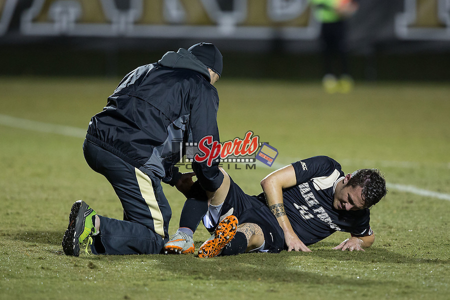 Michael Gamble (10) of the Wake Forest Demon Deacons has his right knee checked by the athletic trainer during the game against the Georgia State Panthers at Spry Soccer Stadium on October 20, 2015 in Winston-Salem, North Carolina.  The Demon Deacons defeated the Panthers 5-0.  (Brian Westerholt/Sports On Film)