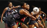 22.02.2018 Fiji's Episake Kahatoka and Malawi's Mwai Kumwenda in action during the Fiji v Malawi Taini Jamison Trophy netball match at the North Shore Events Centre in Auckland. Mandatory Photo Credit ©Michael Bradley.