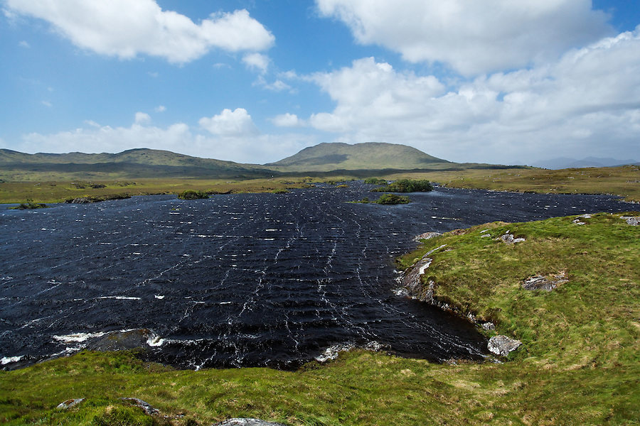 Waves whipped up surface by strong winds on Lough Nahasleam, Connemara, County Galway, Republic of Ireland