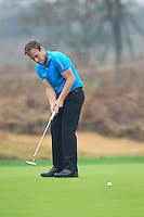 Tyrrell Hatton (ENG) putts on the 14th green during Friday's Round 2 of the 2014 BMW Masters held at Lake Malaren, Shanghai, China 31st October 2014.<br /> Picture: Eoin Clarke www.golffile.ie