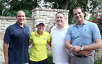 NWA Democrat-Gazette/CARIN SCHOPPMEYER Stacy Lewis, LPGA professional and former Arkansas Razorbacks golfer, is joined by Alex Perwich (from left), Mike Moore and Kees Kruythoff on June 24 at Moore's home in Rogers.