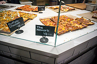 Detroit style pizza in the new Whole Foods Market in Newark, NJ on opening day Wednesday, March 1, 2017. The store is the chain's 17th store to open in New Jersey. The 29,000 square foot store located in the redeveloped former Hahne & Co. department store building is seen as a harbinger of the revitalization of Newark which never fully recovered from the riots in the 1960's.  (© Richard B. Levine)