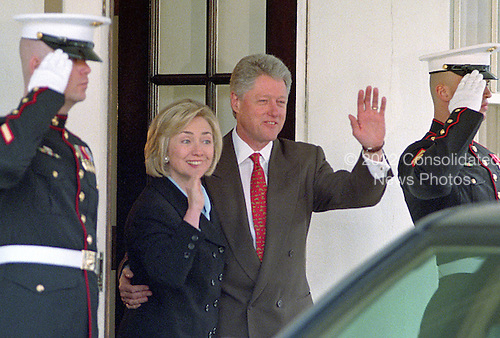 United States President Bill Clinton and first lady Hillary Rodham Clinton wave farewell to King Hussein of Jordan following a meeting at the White House in Washington, D.C on March 19, 1998.<br /> Credit: Ron Sachs / CNP