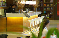 The bar with a row of white chairs. The Restaurant Red at the Hotel Madero Sofitel in Puerto Madero, Buenos Aires Argentina, South America