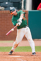 Michael Broad #8 of the Miami Hurricanes makes contact with the baseball against the Boston College Eagles at the 2010 ACC Baseball Tournament at NewBridge Bank Park May 27, 2010, in Greensboro, North Carolina.  The Eagles defeated the Hurricanes 12-10 in 10 innings.  Photo by Brian Westerholt / Four Seam Images