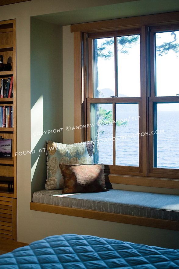 A bedroom window seat offers a quiet place to look out at the water. this image is available through an alternate architectural stock image agency, Collinstock located here: http://www.collinstock.com