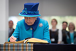© Joel Goodman - 07973 332324 . No syndication permitted . 14/11/2013 . Manchester , UK . The Queen signs the guest book . Queen Elizabeth II and the Duke of Edinburgh visit the Coop building at 1 Angel Square , Manchester , this morning ( 14th November 2013 ) . Photo credit : Joel Goodman