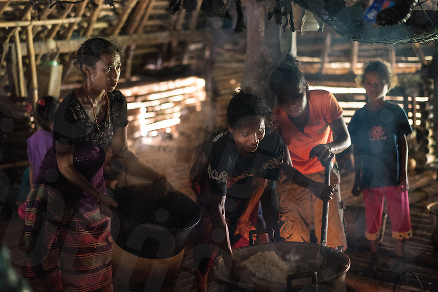 March 29, 2016 - Wainyapu (Indonesia). Peter's mother and sisters cook rice, pig, dog and chicken for all the guests of the house. The Pasola festival is not only a religous tradition, but it also represents a unique social opportunity for the families to stay together. © Thomas Cristofoletti / Ruom