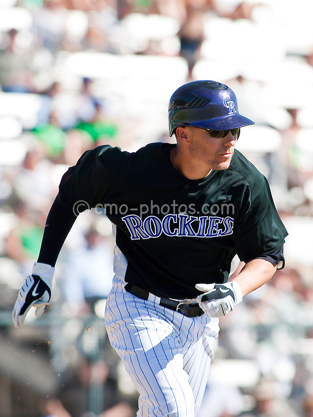 Mar 17, 2009; Tucson, AZ, USA; Colorado Rockies second baseman Jeff Baker runs down the first base line during a spring training game against the Kansas City Royals at Hi Corbett Field.  The Royals and the Rockies tied 9-9 after 10 innings.