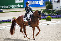 DEN-Cathrine Dufour rides Bohemian during the Deutsche Bank Prize, Grand Prix Dressage of Aachen. 2019 GER-CHIO Aachen Weltfest des Pferdesports. Sunday 21 July. Copyright Photo: Libby Law Photography