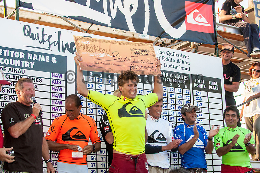 Waimea Bay, North Shore, Oahu, Hawaii December 15 2004.<br /> Bruce Irons (HAW) on his winning 100 point wave. The 2004 Quiksilver Eddie Aikau Big Wave Invitational won by Hawaiian surfer Bruce Irons (HAW) from the island of Kauai was held in 30 to 40' waves at Waimea Bay on the North Shore of Oahu Hawaii, today, December 15th 2004. Irons rode one of the biggest waves of the day which was at least 30' in height, taking home US$55,000 in prize money.  Photo: Joliphotos.com