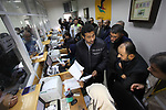 Deputy Qatari Ambassador Khaled Hardan visits a Post Office as Palestinian employees of Gaza strip wait to receive their salaries, in Gaza city, on December 7, 2018. Photo by Mahmoud Ajour