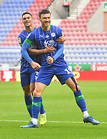 Wigan Athletic's Kieffer Moore is congratulated on scoring his team's opening goal<br /> <br /> Photographer Dave Howarth/CameraSport<br /> <br /> The EFL Sky Bet Championship - Wigan Athletic v Fulham - Wednesday July 22nd 2020 - DW Stadium - Wigan<br /> <br /> World Copyright © 2020 CameraSport. All rights reserved. 43 Linden Ave. Countesthorpe. Leicester. England. LE8 5PG - Tel: +44 (0) 116 277 4147 - admin@camerasport.com - www.camerasport.com