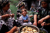 Cepne Family..The severe geography of these mountains helps to retain culture. Girls in this village vote every year as to whether they will continue to wear these ancient outfits that date back to the Genoese traders. On the other side of the mountains, clothing is completely homogenous. ..
