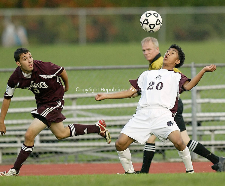 TORRINGTON, CT, 10/01/08- 100108BZ01- Torrington's Freddy Muy (20) tries to control the ball as Naugatuck's James Canale (5) moves in during their game at Torrington High Wednesday night.<br /> Jamison C. Bazinet Republican-American