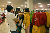 Shoppers flock to the Queens Center in New York on Labor Day, Monday, September 7, 2009 to take advantage of the back to school and the Labor Day sales. (© Frances M. Roberts)