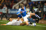 St Johnstone v Hibs..28.11.12      SPL.Murray Davidson is brough down by Tom Taiwo.Picture by Graeme Hart..Copyright Perthshire Picture Agency.Tel: 01738 623350  Mobile: 07990 594431